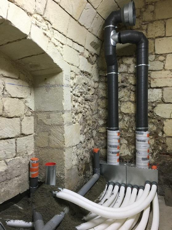 Passage conduits de ventilation